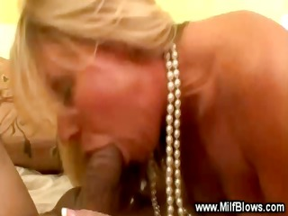 pleasant blond cougar is engulfing a cock