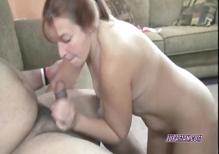 redhead liisa on her knees and swallowing a jock