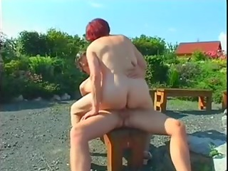 bulky aged redhead fucked outdoors