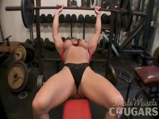older brawny woman plays with large clit