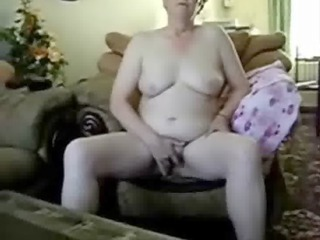 aged lady masturbates in front of cam